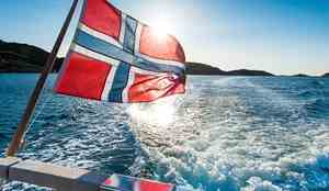 Norwegian flag at the back of a boat